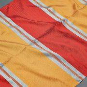 Tkanina zasłonowa DKM 1453 /9 czerwony z pomarańczowym